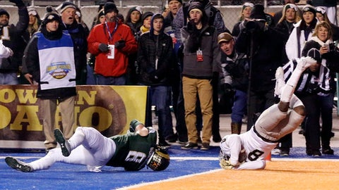 Idaho wide receiver Jacob Sannon, right, is pushed head over heels into the end zone for a touchdown by Colorado State defensive back Jake Schlager during the second half of the Famous Idaho Potato Bowl NCAA college football game in Boise, Idaho, Thursday, Dec. 22, 2016. (AP Photo/Otto Kitsinger)