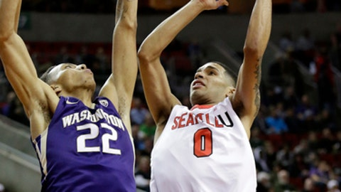Washington's Dominic Green (22) defends as Seattle's Brendan Westendorf shoots during the first half of an NCAA college basketball game Thursday, Dec. 22, 2016, in Seattle. (AP Photo/Elaine Thompson)