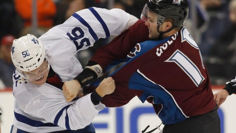 Toronto Maple Leafs center Byron Froese, left, fights with Colorado Avalanche defenseman Cody Goloubef during the third period of an NHL hockey game Thursday, Dec. 22, 2016, in Denver. The Maple Leafs won 6-0. (AP Photo/David Zalubowski)