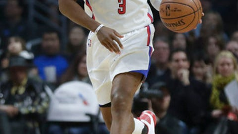 Los Angeles Clippers guard Chris Paul brings the ball down court against the Denver Nuggets during the first half of an NBA basketball game in Los Angeles, Tuesday, Dec. 20, 2016. (AP Photo/Chris Carlson)