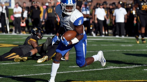 FILE - In this Oct. 22, 2016, file photo, Middle Tennessee wide receiver Richie James scores a touchdown after catching a pass during the first half of an NCAA college against Missouri, in Columbia, Mo. Middle tennessee will play Hawaii in the Hawaii Bowl. (AP Photo/L.G. Patterson, File)