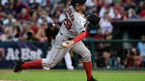 Boston Red Sox relief pitcher Brad Ziegler throws to a Cleveland Indians batter during the sixth inning of Game 2 of a baseball American League Division Series, Friday, Oct. 7, 2016, in Cleveland. (AP Photo/David Dermer)