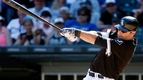 FILE - In this June 25, 2016, file photo, Chicago White Sox's Alex Avila hits a solo home run during the eighth inning of a baseball game against the Toronto Blue Jays in Chicago. The Detroit Tigers are bringing back Avila with a $2 million, one-year contract. (AP Photo/Nam Y. Huh, File)