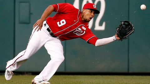 FILE - In this May 14, 2016, file photo, Washington Nationals center fielder Ben Revere (9) catches a ball hit by Miami Marlins' Giancarlo Stanton for an out during the third inning of the second baseball game of a split doubleheader in Washington. Revere has agreed to a $4 million, one-year contract with the Los Angeles Angels, three weeks after Washington allowed him to become a free agent. (AP Photo/Alex Brandon, File)