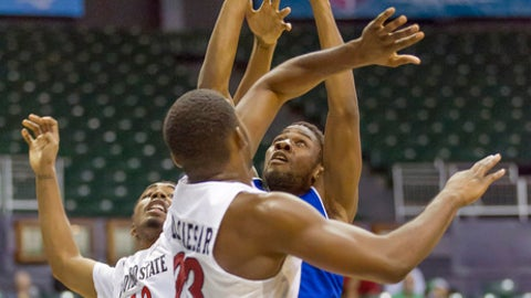 Tulsa guard Sterling Taplin, right, shoots while defended by San Diego State guards Jeremy Hemsley (42) and Montaque Gill-Caesar (23) during the first half of an NCAA college basketball game at the Diamond Head Classic, Friday, Dec. 23, 2016, in Honolulu. (AP Photo/Eugene Tanner)