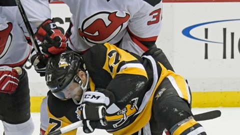 New Jersey Devils left wing Vernon Fiddler (38) ties up Pittsburgh Penguins right wing Patric Hornqvist (72) in front of the net during the second period of an NHL hockey game Friday, Dec. 23, 2016, in Pittsburgh. (AP Photo/Fred Vuich)