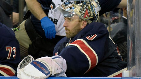 New York Rangers goaltender Henrik Lundqvist sits on the bench after getting pulled from the NHL hockey game during the second period against the Minnesota Wild on Friday, Dec. 23, 2016, at Madison Square Garden in New York. (AP Photo/Bill Kostroun)