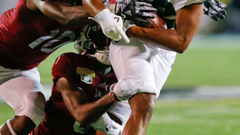 Ohio wide receiver Jordan Reid carries Troy defender Tyquae Russell (10) during the first half of the Dollar General Bowl NCAA college football game, Friday, Dec. 23, 2016, in Mobile, Ala. (AP Photo/Brynn Anderson)