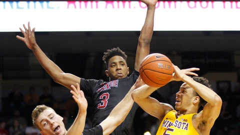 Arkansas State guards Devin Carter (3) and Conor Kern (12) strip the ball from Minnesota guard Amir Coffey (5) in the second half of an NCAA college basketball game Friday, Dec. 23, 2016, in Minneapolis.(AP Photo/Andy Clayton-King)