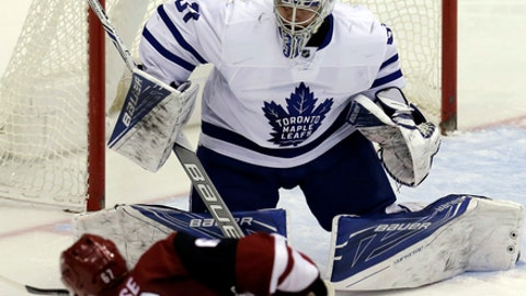 Toronto Maple Leafs goalie Frederik Andersen (31) makes the save on Arizona Coyotes left wing Lawson Crouse during the second period of an NHL hockey game, Friday, Dec. 23, 2016, in Glendale, Ariz. (AP Photo/Rick Scuteri)