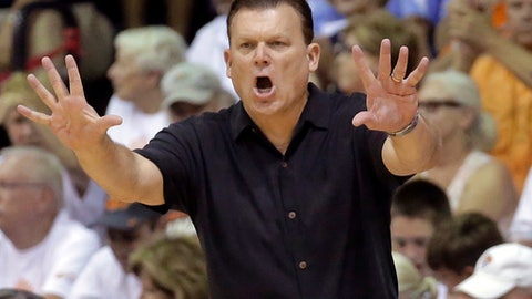 FILE - In this Nov. 23, 2016, file photo, Oklahoma State coach Brad Underwood shouts to his team during the second half of an NCAA college basketball game against Georgetown at the Maui Invitational in Lahaina, Hawaii. Just months after Oklahoma State fired Travis Ford, Underwood has the Cowboys knocking on the door of the AP Top 25. (AP Photo/Rick Bowmer)