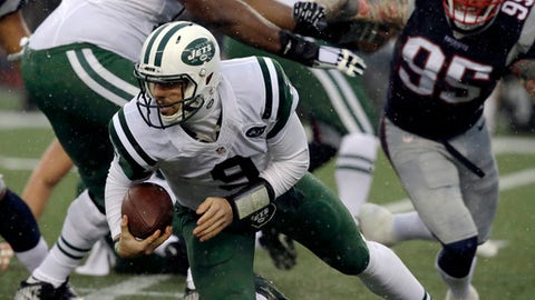 New York Jets quarterback Bryce Petty (9) scrambles from New England Patriots defensive end Chris Long (95) during the first half of an NFL football game, Saturday, Dec. 24, 2016, in Foxborough, Mass. (AP Photo/Charles Krupa)