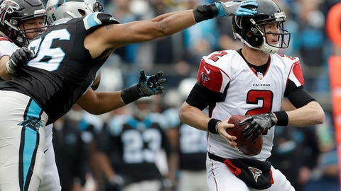 Atlanta Falcons' Matt Ryan (2) looks to pass under pressure from Carolina Panthers' Wes Horton (96) in the first half of an NFL football game in Charlotte, N.C., Saturday, Dec. 24, 2016. (AP Photo/Bob Leverone)