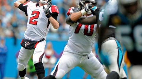 Atlanta Falcons' Matt Ryan (2) looks to pass against the Carolina Panthers in the first half of an NFL football game in Charlotte, N.C., Saturday, Dec. 24, 2016. (AP Photo/Mike McCarn)