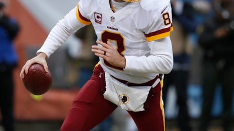 Washington Redskins quarterback Kirk Cousins (8) runs against the Chicago Bears during the first half of an NFL football game, Saturday, Dec. 24, 2016, in Chicago. (AP Photo/Nam Y. Huh)