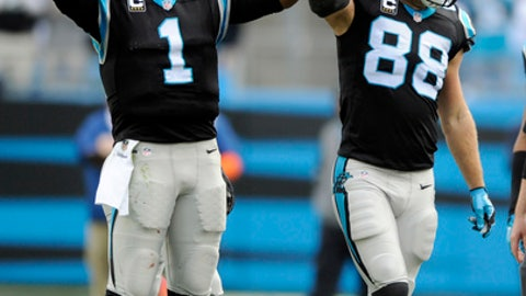 Carolina Panthers' Greg Olsen (88) celebrates with Cam Newton (1) after Olsen passed 1,000 yards receiving in the first half of an NFL football game against the Atlanta Falcons in Charlotte, N.C., Saturday, Dec. 24, 2016. (AP Photo/Mike McCarn)