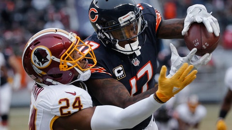 Chicago Bears wide receiver Alshon Jeffery (17) pulls in a reception as Washington Redskins cornerback Josh Norman (24) defends during the first half of an NFL football game, Saturday, Dec. 24, 2016, in Chicago. (AP Photo/Charles Rex Arbogast)