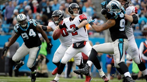 Atlanta Falcons' Matt Ryan (2) looks to pass against the Carolina Panthers in the second half of an NFL football game in Charlotte, N.C., Saturday, Dec. 24, 2016. (AP Photo/Bob Leverone)