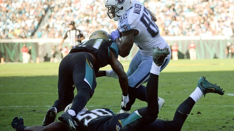 Tennessee Titans tight end Delanie Walker, center, scores a touchdown on a 14-yard pass play against Jacksonville Jaguars cornerback Prince Amukamara, left, and outside linebacker Telvin Smith (50) during the second half of an NFL football game, Saturday, Dec. 24, 2016, in Jacksonville, Fla. (AP Photo/Phelan M. Ebenhack)