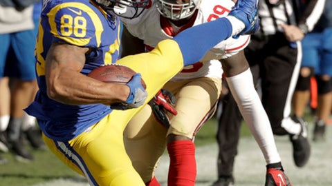 Los Angeles Rams tight end Lance Kendricks catches a pass infront of San Francisco 49ers free safety Jaquiski Tartt during the first half of an NFL football game, Saturday, Dec. 24, 2016, in Los Angeles. (AP Photo/Rick Scuteri)