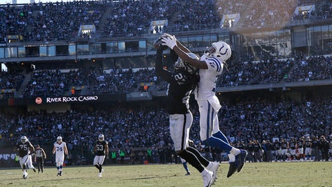 Oakland Raiders free safety Reggie Nelson (27) intercepts a pass in front of Indianapolis Colts wide receiver T.Y. Hilton during the first half of an NFL football game in Oakland, Calif., Saturday, Dec. 24, 2016. (AP Photo/Tony Avelar)