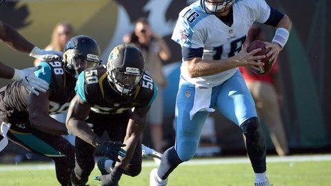 Tennessee Titans quarterback Matt Cassel (16) scrambles away from Jacksonville Jaguars outside linebacker Telvin Smith (50) and defensive end Chris Smith (98) during the second half of an NFL football game, Saturday, Dec. 24, 2016, in Jacksonville, Fla. (AP Photo/Phelan M. Ebenhack)