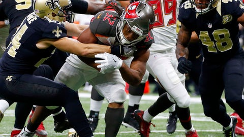 Tampa Bay Buccaneers running back Jacquizz Rodgers (32) carries for a touchdown against New Orleans Saints cornerback Sterling Moore and free safety Vonn Bell (48) in the second half of an NFL football game in New Orleans, Saturday, Dec. 24, 2016. (AP Photo/Butch Dill)