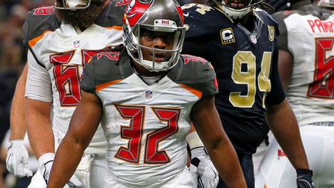 Tampa Bay Buccaneers running back Jacquizz Rodgers (32) celebrates his touchdown in the second half of an NFL football game against the New Orleans Saints in New Orleans, Saturday, Dec. 24, 2016. (AP Photo/Butch Dill)