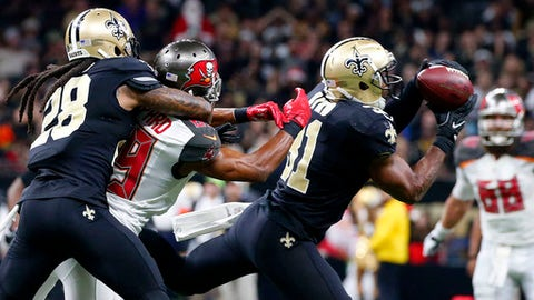 New Orleans Saints free safety Jairus Byrd (31) intercepts a pass intended for Tampa Bay Buccaneers wide receiver Russell Shepard (89) as Saints cornerback B.W. Webb (28) covers in the second half of an NFL football game against the Tampa Bay Buccaneers in New Orleans, Saturday, Dec. 24, 2016. (AP Photo/Butch Dill)
