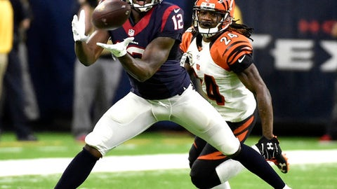 Houston Texans' Keith Mumphery (12) catches a pass as Cincinnati Bengals' Adam Jones (24) defends during the second half of an NFL football game Saturday, Dec. 24, 2016, in Houston. (AP Photo/Eric Christian Smith)