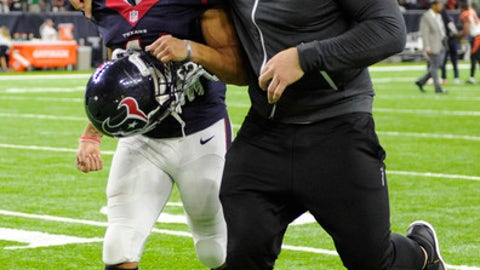 Houston Texans' J.J. Watt, right, and Jonathan Grimes celebrate after beating the Cincinnati Bengals in an NFL football game Saturday, Dec. 24, 2016, in Houston. The Texans won 12-10. (AP Photo/Eric Christian Smith)