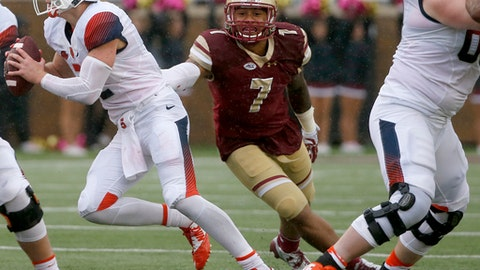 FILE - In this Oct. 22, 2016, file photo, Boston College defensive end Harold Landry (7) reaches out for Syracuse quarterback Eric Dungey (2) during the first half of an NCAA college football game, in Boston. Maryland and Boston College are meeting in Detroit for the Quick Lane Bowl on Dec. 26, 2016. (AP Photo/Mary Schwalm, File)