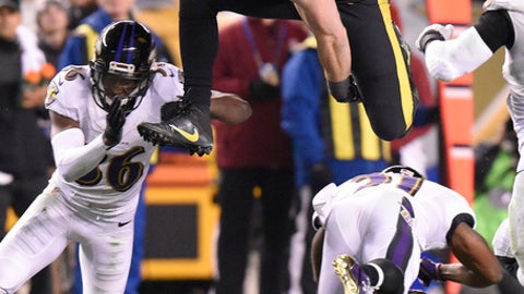 Pittsburgh Steelers tight end Jesse James (81) leaps over Baltimore Ravens cornerback Chris Lewis-Harris (31) before being tackled by cornerback Tavon Young (36) during the second half of an NFL football game in Pittsburgh, Sunday, Dec. 25, 2016. (AP Photo/Don Wright)