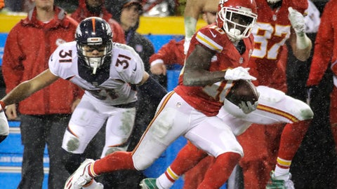 Kansas City Chiefs wide receiver Tyreek Hill (10) runs past Denver Broncos safety Justin Simmons (31) for a 70-yard touchdown, with tight end Travis Kelce (87) running alongside him during the first half of an NFL football game against the Denver Broncos in Kansas City, Mo., Sunday, Dec. 25, 2016. (AP Photo/Charlie Riedel)