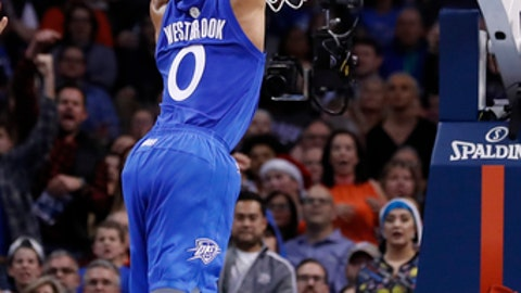 Oklahoma City Thunder guard Russell Westbrook (0) dunks against the Minnesota Timberwolves during the first half of an NBA basketball game in Oklahoma City, Sunday, Dec. 25, 2016. (AP Photo/Alonzo Adams)