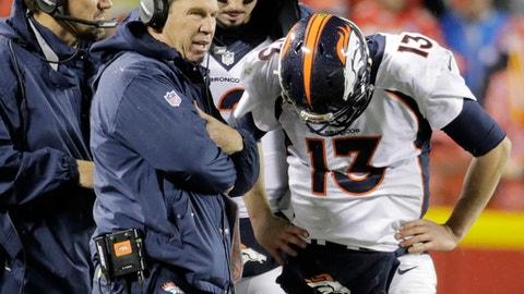 Denver Broncos head coach Gary Kubiak talks to quarterback Trevor Siemian (13) during the first half of an NFL football game against the Kansas City Chiefs in Kansas City, Mo., Sunday, Dec. 25, 2016. (AP Photo/Charlie Riedel)