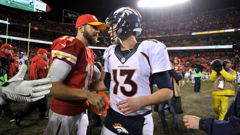 Kansas City Chiefs quarterback Alex Smith (11) and Denver Broncos quarterback Trevor Siemian (13) meet following an NFL football game in Kansas City, Mo., Sunday, Dec. 25, 2016. The Chiefs won 33-10. (AP Photo/Ed Zurga)
