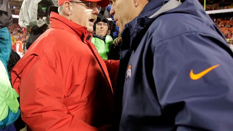 Kansas City Chiefs head coach Andy Reid, left, and Denver Broncos head coach Gary Kubiak meet following an NFL football game in Kansas City, Mo., Sunday, Dec. 25, 2016. The Chiefs won 33-10. (AP Photo/Charlie Riedel)