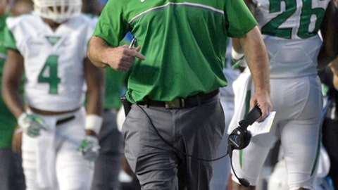 FILE - In this Saturday, Sept. 17, 2016, file photo, North Texas coach Seth Littrell, center, reacts after quarterback Mason Fine was sacked by Florida in the end zone for a safety during the first half of an NCAA college football game in Gainesville, Fla. North Texas plays Army in the Heart of Dallas Bowl on Tuesday, Dec. 27. (AP Photo/Phelan M. Ebenhack, File)