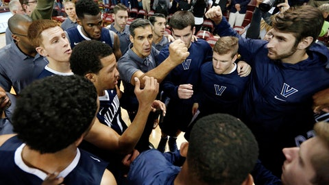 FILE - In this Nov. 20, 2016, file photo, Villanova's head coach Jay Wright, center, huddles his team after they beat Central Florida 67-57 in the NCAA college basketball game at the Charleston Classic at TD Arena in Charleston, S.C. Villanova starts its fourth week as the No. 1 team in The Associated Press Top 25 released on Monday, Dec. 26, 2016.  (AP Photo/Mic Smith, File)