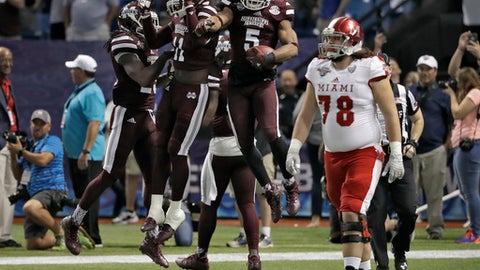 Mississippi State defensive back Cedric Jiles (5) celebrates with teammates as he holds the football after recovering a blocked field goal by Miami (Ohio) place kicker Nick Dowd during the second half of the St. Petersburg Bowl NCAA college football game Monday, Dec. 26, 2016, in St. Petersburg, Fla. Mississippi State won the game 17-16. (AP Photo/Chris O'Meara)
