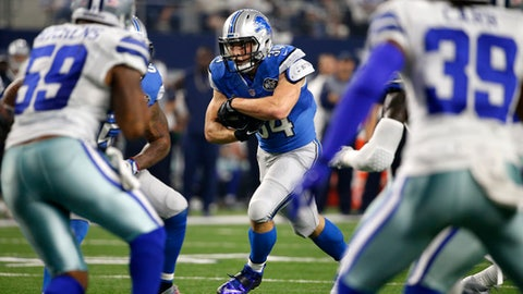 Dallas Cowboys' Anthony Hitchens (59) and Brandon Carr (39) defend as Detroit Lions' Zach Zenner (34) carries the ball to the end zone for a touchdown in the first half of an NFL football game, Monday, Dec. 26, 2016, in Arlington, Texas. (AP Photo/Michael Ainsworth)