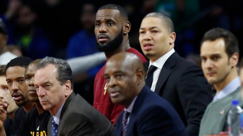 Cleveland Cavaliers forward LeBron James, left, watches the NBA basketball game against the Detroit Pistons from the bench with head coach Tyronn Lue during the first half, Monday, Dec. 26, 2016, in Auburn Hills, Mich. (AP Photo/Duane Burleson)