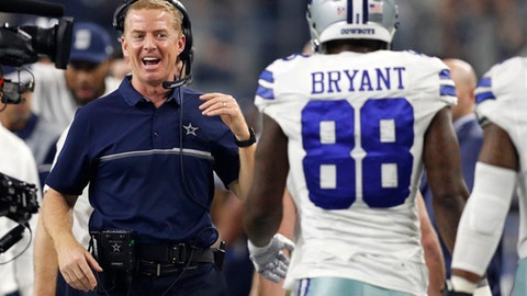 Dallas Cowboys head coach Jason Garrett celebrates with Dez Bryant (88) after Bryant caught a touchdown pass late in the first half of an NFL football game against the Detroit Lions on Monday, Dec. 26, 2016, in Arlington, Texas. (AP Photo/Brandon Wade)