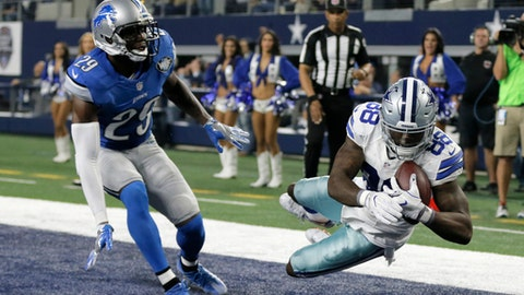 Detroit Lions' Johnson Bademosi (29) is unable to stop Dallas Cowboys' Dez Bryant (88) from catching a touchdown pass late in the first half of an NFL football game, Monday, Dec. 26, 2016, in Arlington, Texas. (AP Photo/Brandon Wade)