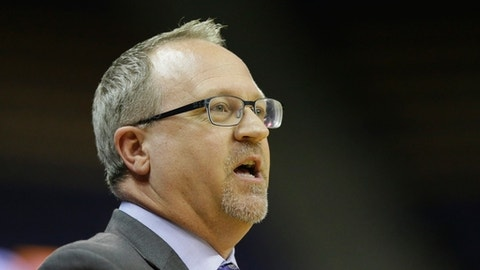 FILE - In this Sunday, Dec. 18, 2016, file photo, Washington head coach Mike Neighbors watches from the sideline in the second half of an NCAA college basketball game against Savannah State in Seattle. Mike Neighbors loves to crunch numbers. Washington's analytics-minded coach was impressed with what the Pac-12 Conference accomplished in the nonconference portion of the season. (AP Photo/Ted S. Warren, File)