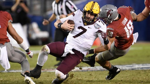 Minnesota quarterback Mitch Leidner (7) runs for a six-yard gain past Washington State safety Shalom Luani (18) during the first half of the Holiday Bowl NCAA college football game, Tuesday, Dec. 27, 2016, in San Diego. (AP Photo/Denis Poroy)