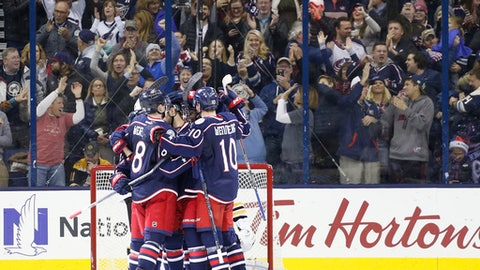 Columbus Blue Jackets players celebrate a goal against the Boston Bruins during the third period of an NHL hockey game Tuesday, Dec. 27, 2016, in Columbus, Ohio. The Blue Jackets won 4-3. (AP Photo/Jay LaPrete)