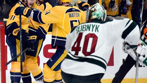 Nashville Predators center Reid Boucher (11) celebrates with defenseman Petter Granberg (8), of Sweden, and left wing Austin Watson (51) after Boucher scored a goal against Minnesota Wild goalie Devan Dubnyk (40) during the second period of an NHL hockey game Tuesday, Dec. 27, 2016, in Nashville, Tenn. (AP Photo/Mark Zaleski)