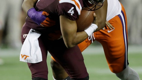 "FILE - In a Saturday, Dec. 3, 2016 file photo, Clemson defensive tackle Dexter Lawrence (90) sacks Virginia Tech quarterback Jerod Evans (4), during the second half of the Atlantic Coast Conference championship NCAA college football game, in Orlando, Fla. Lawrence, the agile freshman who has bedeviled offensive lines, has done the same to defensive opponents as part of the Tigers' ""Jumbo Package."" (AP Photo/Chris O'Meara, File)"
